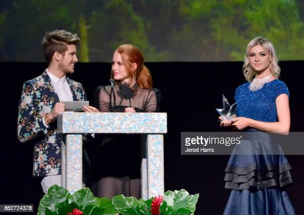 Joey Graceffa and Madelaine Petsch speak onstage at the Environmental Media Association's 27th Annual EMA Awards at Barkar Hangar on September 23...