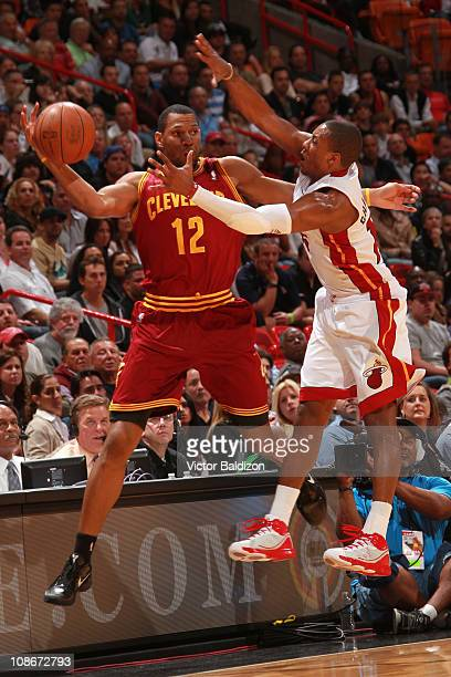 Joey Graham of the Cleveland Cavaliers attempts to save a loose ball against Mario Chalmers of the Miami Heat on January 31 2011 at American Airlines...