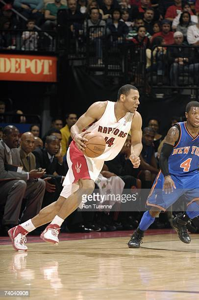 Joey Graham of the Toronto Raptors moves the ball against Nate Robinson of the New York Knicks during the game at Air Canada Centre on April 15 2007...