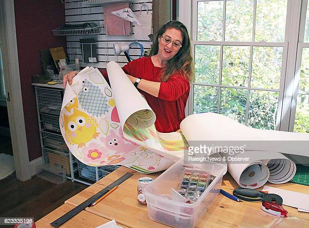 Joey Halloway unspools giant stickers in her Orange County home studio She's covered her 2007 Honda Odyssey in farm animals Disney's Phineas and Ferb...
