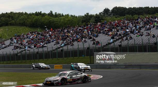 Joey Hand of USA and BMW Team RBM drives during the third round of the DTM 2014 German Touring Car Championship at Hungaroring on June 01 2014 in...