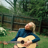 Joey Heatherton playing guitar in her backyard Rockville Centre Long Island NY 17 years old