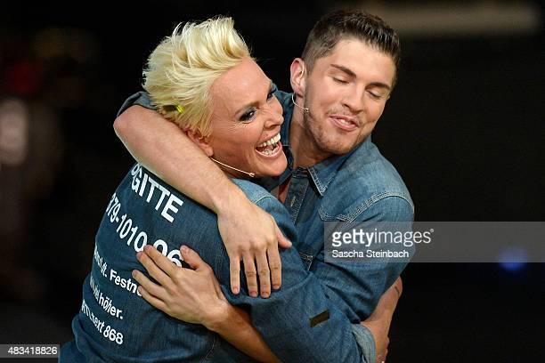 Joey Heindle hugs winner Brigitte Nielsen during the final of the television show 'Ich bin ein Star lasst mich wieder rein' on August 8 2015 in...
