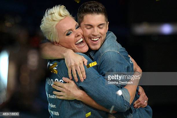 Joey Heindle hugs winner Brigitte Nielsen during the final of the television show 'Ich bin ein Star lasst mich wieder rein' on August 8 2015 in...