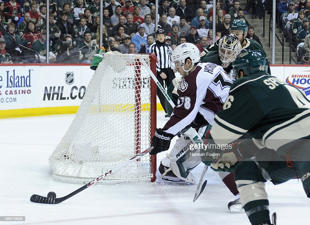 <a gi-track='captionPersonalityLinkClicked' href=/galleries/search?phrase=Joey+Hishon&family=editorial&specificpeople=4782590 ng-click='$event.stopPropagation()'>Joey Hishon</a> #38 of the Colorado Avalanche controls the puck in his NHL debut against <a gi-track='captionPersonalityLinkClicked' href=/galleries/search?phrase=Jared+Spurgeon&family=editorial&specificpeople=4594192 ng-click='$event.stopPropagation()'>Jared Spurgeon</a> #46 of the Minnesota Wild during the first period in Game Four of the First Round of the 2014 NHL Stanley Cup Playoffs on April 24, 2014 at Xcel Energy Center in St Paul, Minnesota. The Wild defeated the Avalanche 2-1.