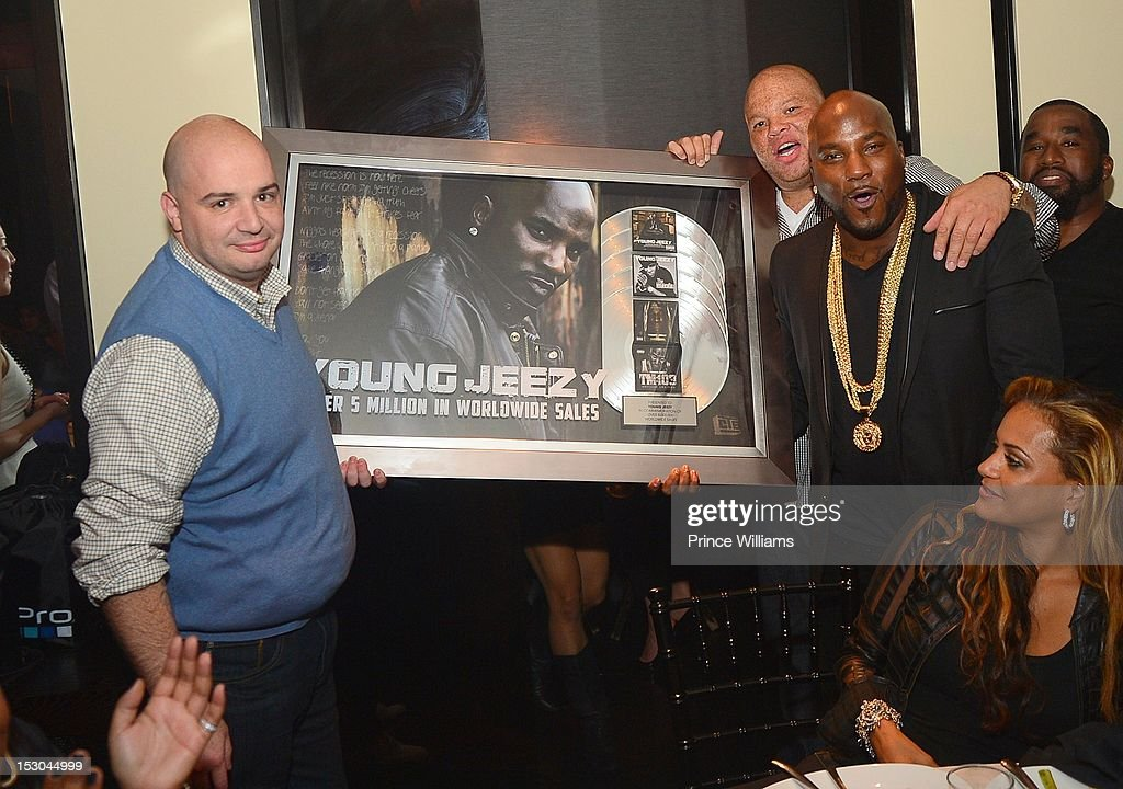 Joey IE, Shawn Pecas and <a gi-track='captionPersonalityLinkClicked' href=/galleries/search?phrase=Young+Jeezy&family=editorial&specificpeople=537540 ng-click='$event.stopPropagation()'>Young Jeezy</a> attend Jeezy's birthday extravaganza at Reign Nightclub on September 28, 2012 in Atlanta, Georgia.