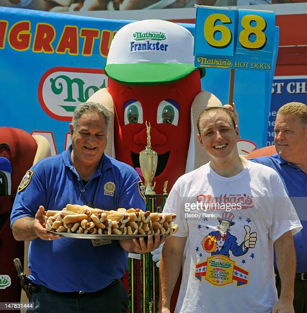 Joey 'Jaws' Chestnut wins the 2012 Mens Competition with 68 hot dogs at the 2012 Nathan's Famous Fourth Of July International Hot Dog Eating Contest...