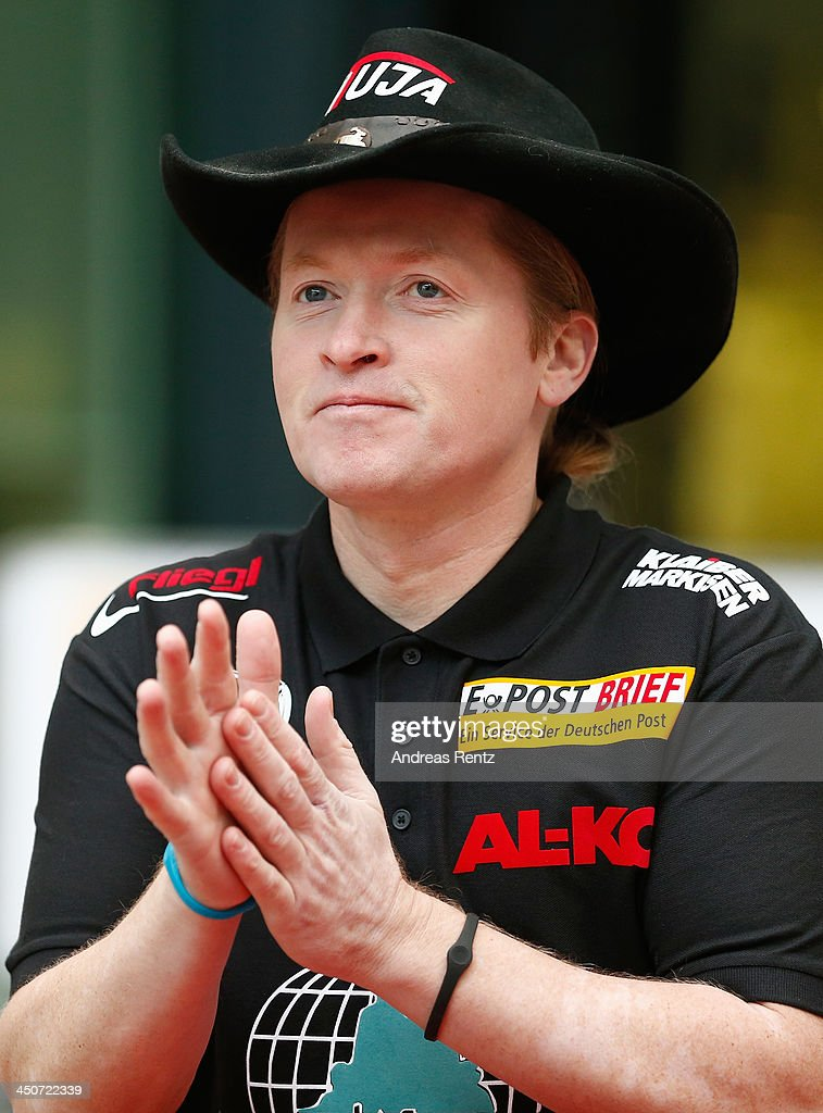 Joey Kelly gestures prior to his ride on a bull riding machine during a photocall on November 20, 2013 in Cologne, Germany. Joey Kelly will go riding 24 hours non stop during the RTL Spenden Marathon on November 22.