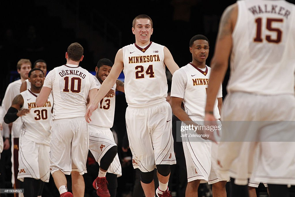 Joey King #24 of the Minnesota Golden Gophers and teammates celebrate a win over Florida State Seminoles during the NIT Championship semifinals at Madison Square Garden on April 1, 2014 in New York City.