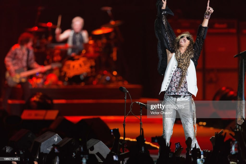 Joey Kramer and singer Steven Tyler of Aerosmith perform on stage at Arena Ciudad de México on October 27 2013 in Mexico City Mexico