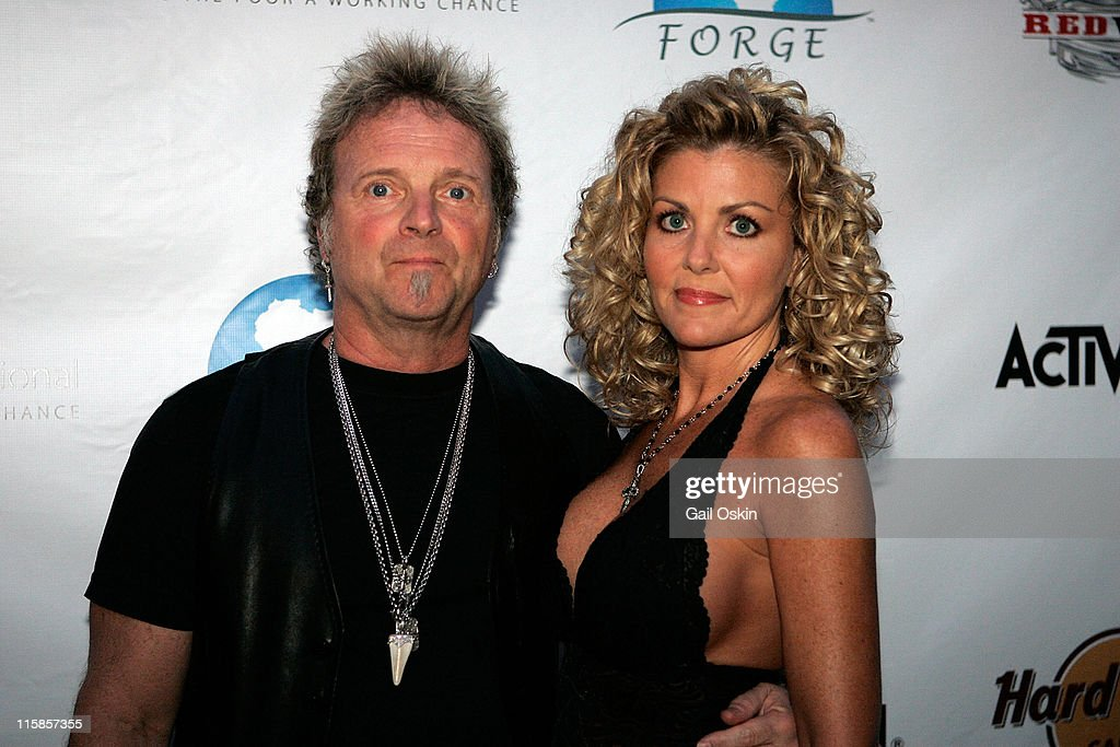 Joey Kramer drummer for Boston rock band Aerosmith and girlfriend Linda attend the 'Guitar Hero Aerosmith' event at the Hard Rock Cafe on August 25...