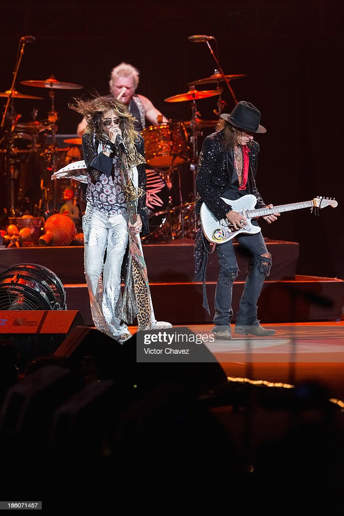Joey Kramer, Steven Tyler and Joe Perry of Aerosmith perform on stage at Arena Ciudad de México on October 27, 2013 in Mexico City, Mexico.