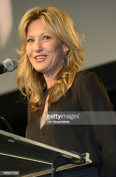 Joey Lauren Adams accepts an award at the Texas Film Hall of Fame Awards at Austin Studios on March 7 2013 in Austin Texas