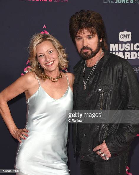 Joey Lauren Adams and Billy Ray Cyrus attend the 2016 CMT Music awards at the Bridgestone Arena on June 8 2016 in Nashville Tennessee