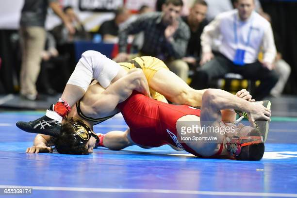 Joey Lavallee of Missouri tries to get an advantage on Dylan Palacio of Cornell during the semifinals of the 157pound weight class of the NCAA...