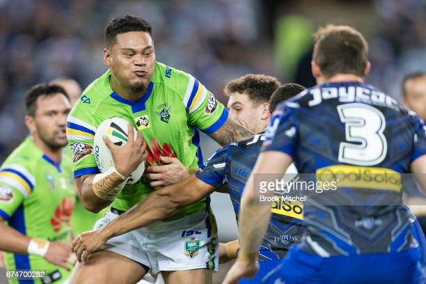 Joey Leilua of the Raiders is tackled during the round nine NRL match between the Canterbury Bulldogs and the Canberra Raiders at ANZ Stadium on...