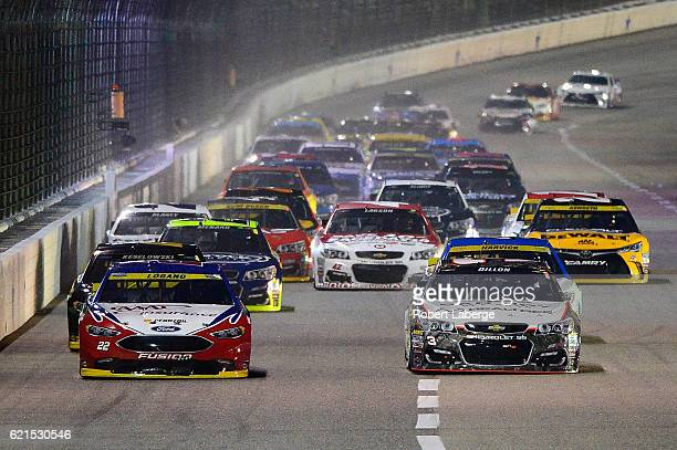 Joey Logano driver of the AAA Ford and Austin Dillon driver of the Realtree/Bad Boy Chevrolet lead the field during the NASCAR Sprint Cup Series AAA...