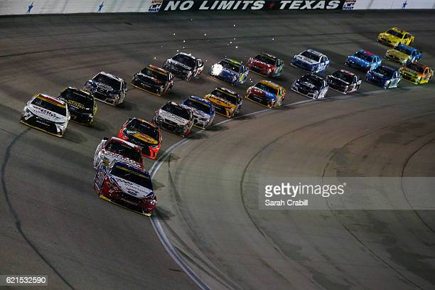 Joey Logano driver of the AAA Ford leads the field during the NASCAR Sprint Cup Series AAA Texas 500 at Texas Motor Speedway on November 6 2016 in...