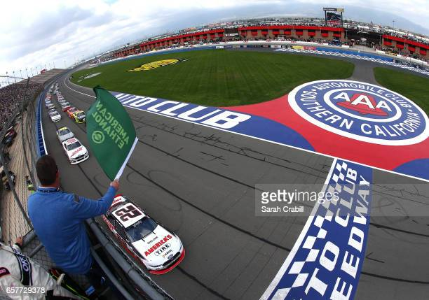 Joey Logano driver of the America's Tire/Discount Tire Ford takes the green flag to start the NASCAR XFINITY Series Service King 300 at Auto Club...