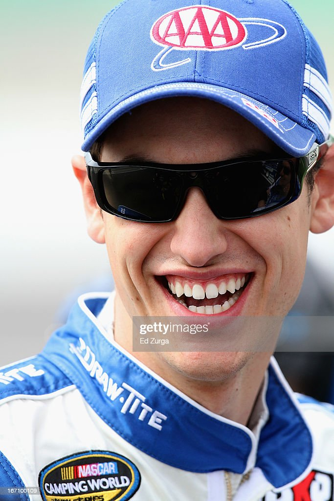 Joey Logano, driver of the #19 Carbon Forged Reese Towpower Ford, stands on the grid during qualifying for the NASCAR Camping World Truck Series SFP 250 at Kansas Speedway on April 20, 2013 in Kansas City, Kansas.