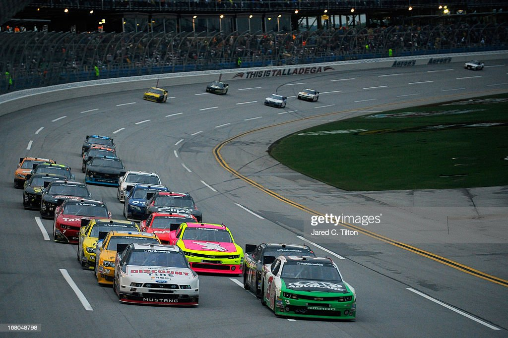 Joey Logano driver of the Discount Tire Ford and Austin Dillon driver of the AdvoCare Chevrolet lead the field during the NASCAR Nationwide Series...