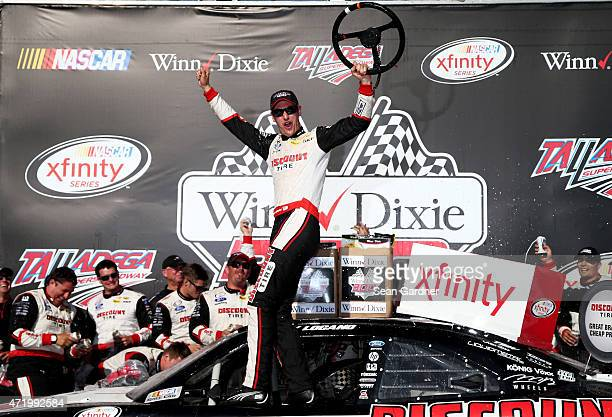 Joey Logano driver of the Discount Tire Ford celebrates in victory lane after winning the NASCAR XFINITY Series Winn Dixie 300 at Talladega...