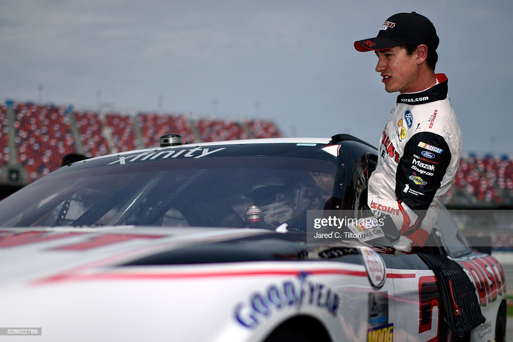 Joey Logano, driver of the #22 Discount Tire Ford, climbs out of his car during qualifying for the NASCAR XFINITY Series Sparks Energy 300 at Talladega Superspeedway on April 30, 2016 in Talladega, Alabama.
