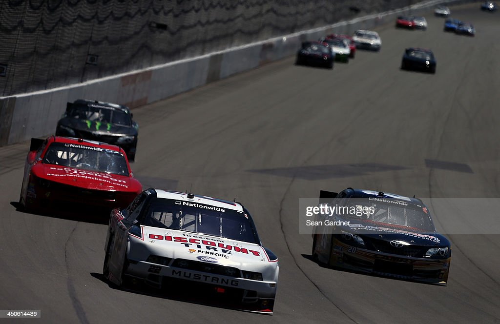 Joey Logano, driver of the #22 Discount Tire Ford, leads a pack of cars during the NASCAR Nationwide Series Ollie's Bargain Outlet 250 at Michigan International Speedway on June 14, 2014 in Brooklyn, Michigan.
