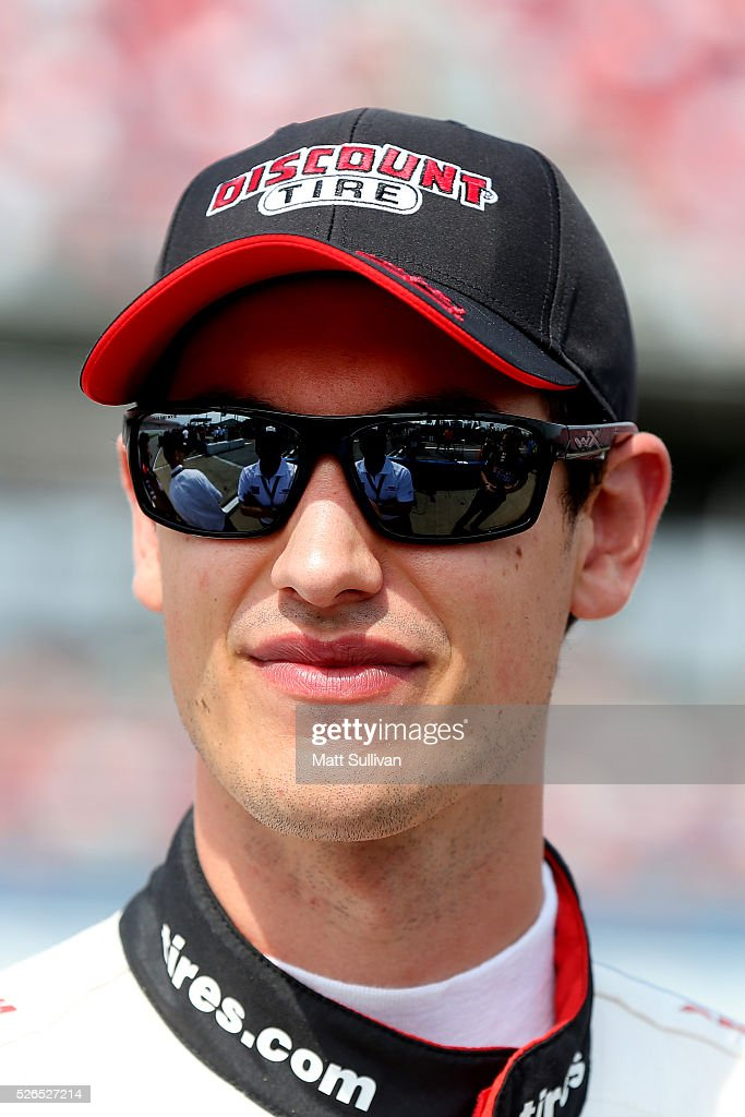 Joey Logano, driver of the #22 Discount Tire Ford, stands on the grid during qualifying for the NASCAR XFINITY Series Sparks Energy 300 at Talladega Superspeedway on April 30, 2016 in Talladega, Alabama.