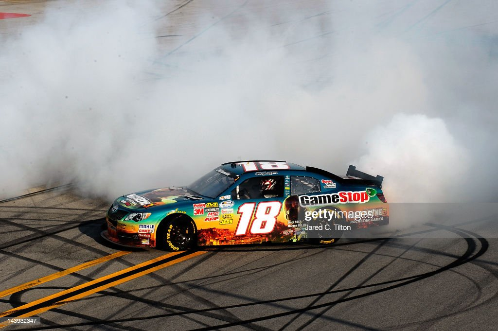 Joey Logano, driver of the #18 GameStop Toyota, burns out to celebrate winning the NASCAR Nationwide Series Aaron's 312 at Talladega Superspeedway on May 5, 2012 in Talladega, Alabama.