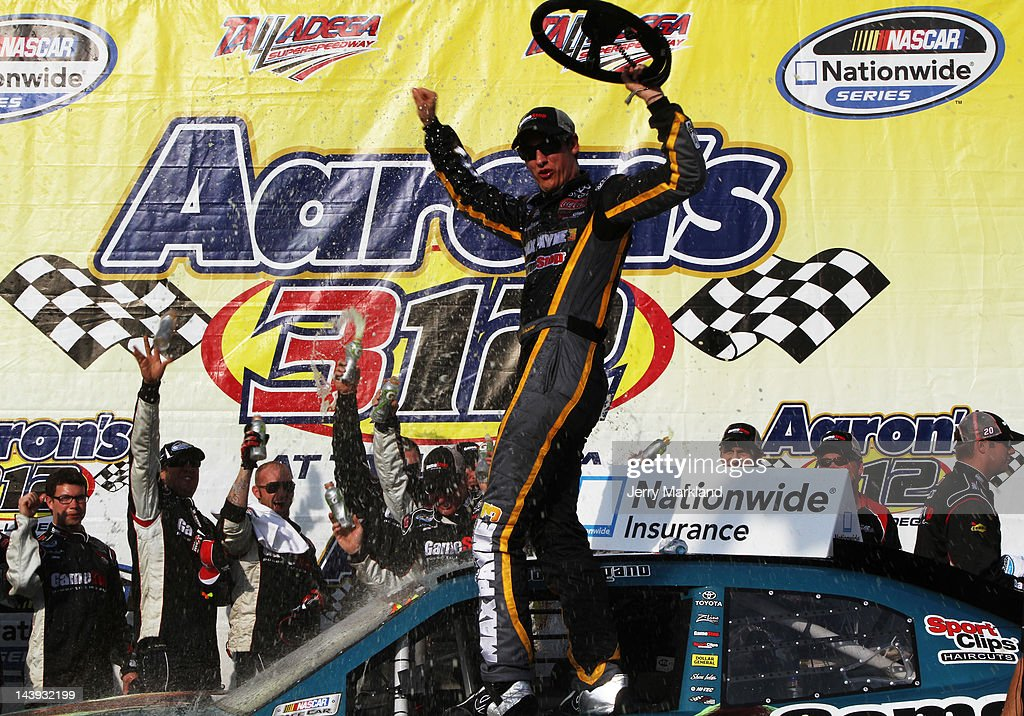 Joey Logano, driver of the #18 GameStop Toyota, celebrates in victory lane after winning the NASCAR Nationwide Series Aaron's 312 at Talladega Superspeedway on May 5, 2012 in Talladega, Alabama.