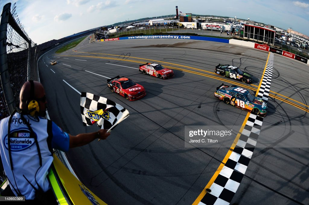 Joey Logano, driver of the #18 GameStop Toyota, crosses the finish line to win the NASCAR Nationwide Series Aaron's 312 at Talladega Superspeedway on May 5, 2012 in Talladega, Alabama.