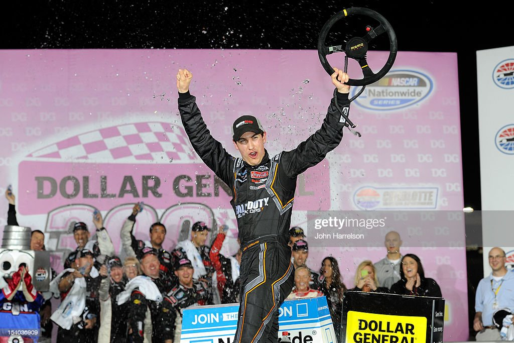 Joey Logano driver of the GameStop/Call Of Duty Black Ops II Toyota celebrates in Victory Lane after winning the NASCAR Nationwide Series Dollar...