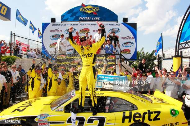 Joey Logano driver of the Hertz Ford celebrates in Victory Lane after winning the NASCAR Nationwide Series 5hour ENERGY 200 at Dover International...