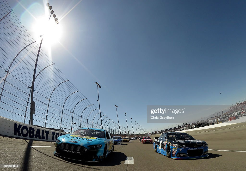 Joey Logano driver of the Pennzoil Platinum Ford and Kasey Kahne driver of the Time Warner Cable Chevrolet lead the field to start the NASCAR Sprint...