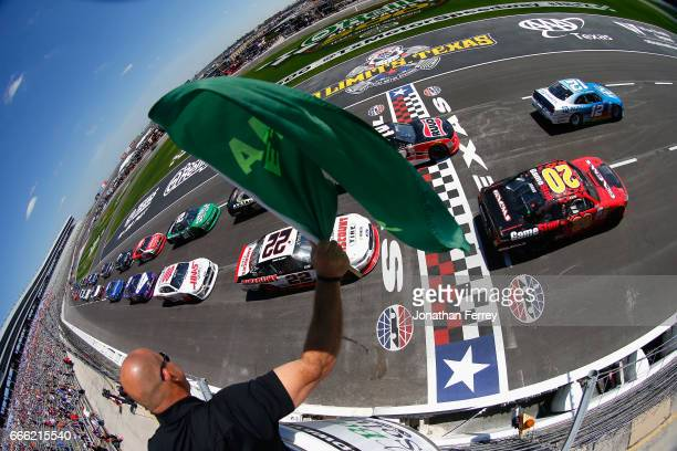 Joey Logano driver of the PPG Ford leads the field past the green flag to start the NASCAR XFINITY Series My Bariatric Solutions 300 at Texas Motor...