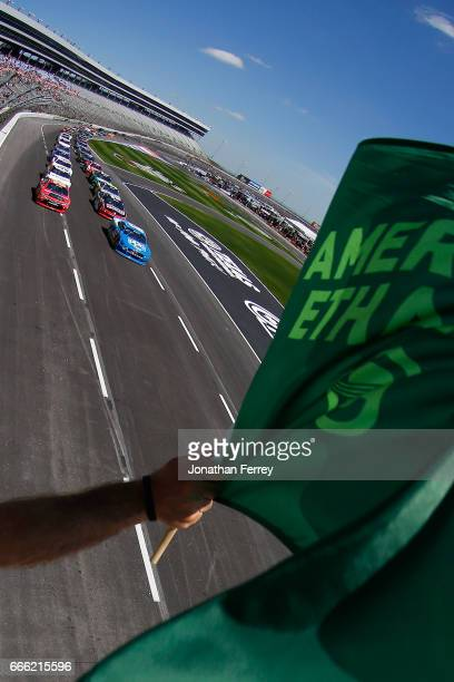 Joey Logano driver of the PPG Ford leads the field to the green flag to start the NASCAR XFINITY Series My Bariatric Solutions 300 at Texas Motor...