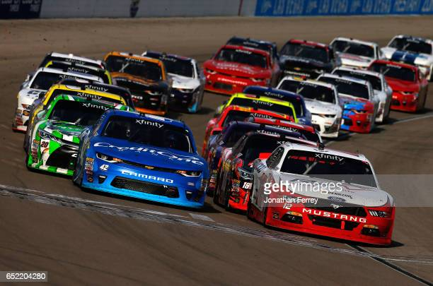 Joey Logano driver of the REV Ford and Kyle Larson driver of the Credit One Bank Chevrolet lead the field to a restart during the NASCAR XFINITY...