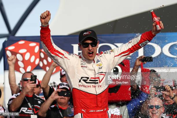 Joey Logano driver of the REV Ford celebrates in Victory Lane after winning the NASCAR XFINITY Series Boyd Gaming 300 at Las Vegas Motor Speedway on...