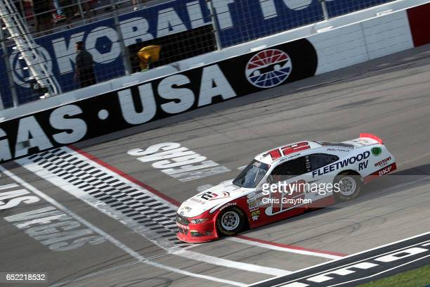 Joey Logano driver of the REV Ford crosses the finish line to win the NASCAR XFINITY Series Boyd Gaming 300 at Las Vegas Motor Speedway on March 11...