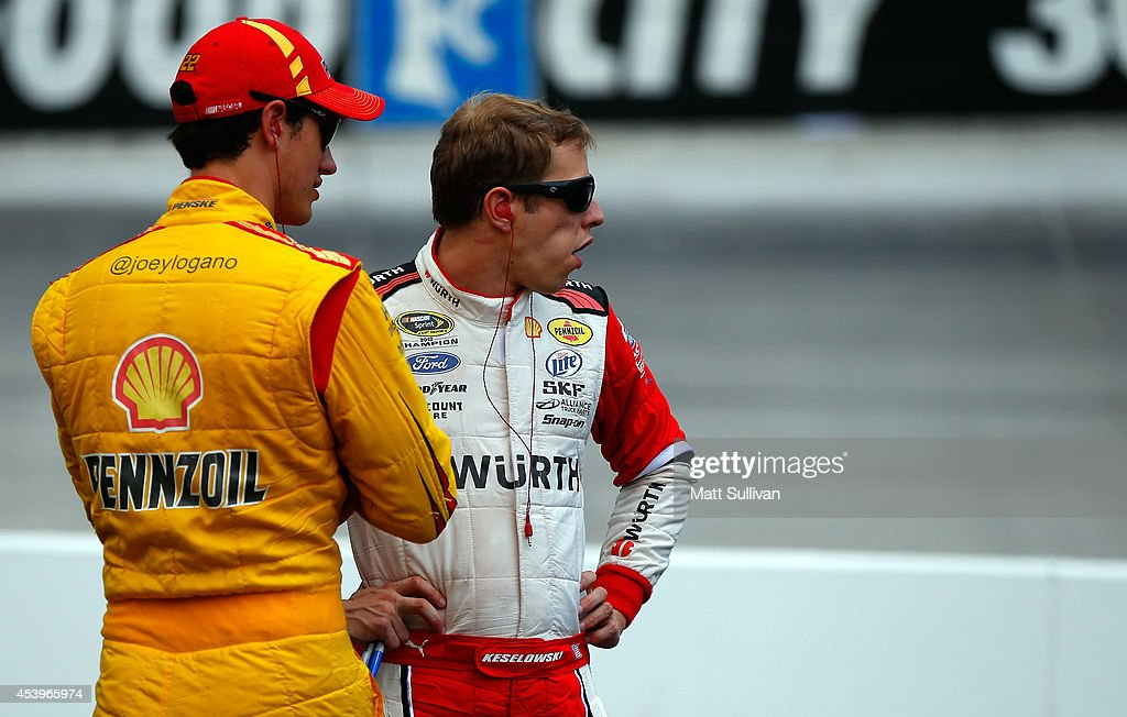 Joey Logano, driver of the #22 Shell Pennzoil Ford, and Brad Keselowski, driver of the #2 Wurth Ford, stand on pit road during practice for the NASCAR Sprint Cup Series Irwin Tools Night Race at Bristol Motor Speedway on August 22, 2014 in Bristol, Tennessee.