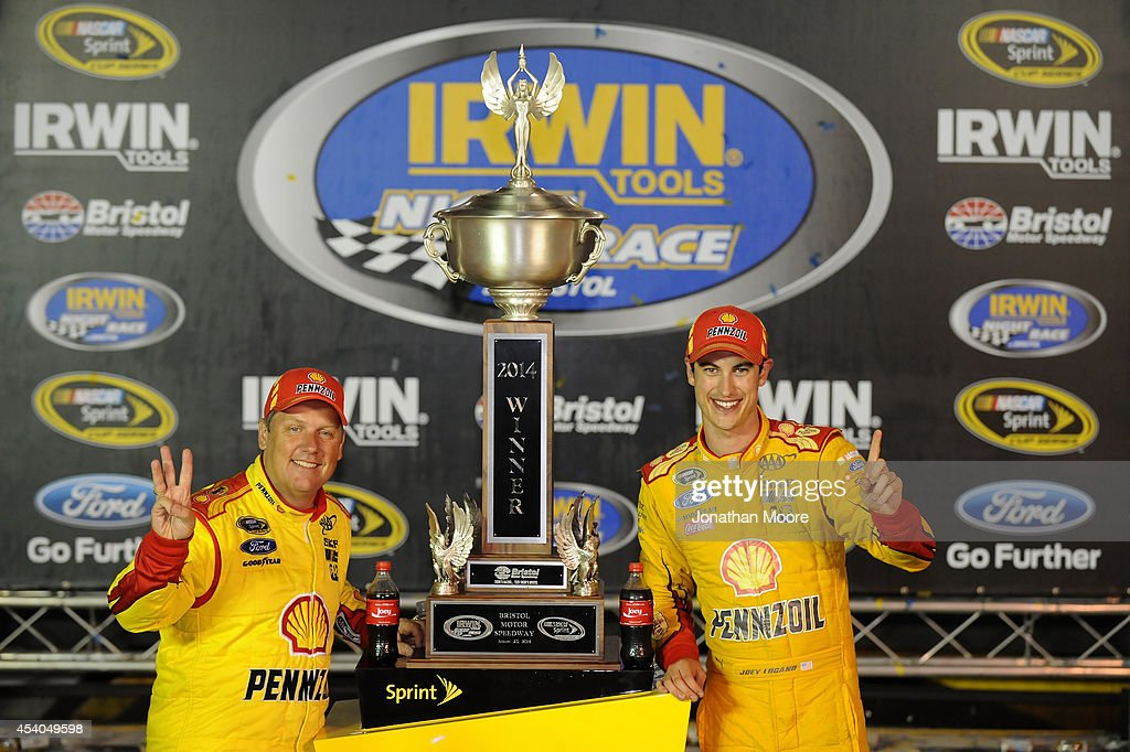 <a gi-track='captionPersonalityLinkClicked' href=/galleries/search?phrase=Joey+Logano&family=editorial&specificpeople=4510426 ng-click='$event.stopPropagation()'>Joey Logano</a>, driver of the #22 Shell Pennzoil Ford, and his crew chief Todd Gordon pose with the trophy in Victory Lane after winning the NASCAR Sprint Cup Series Irwin Tools Night Race at Bristol Motor Speedway on August 23, 2014 in Bristol, Tennessee.