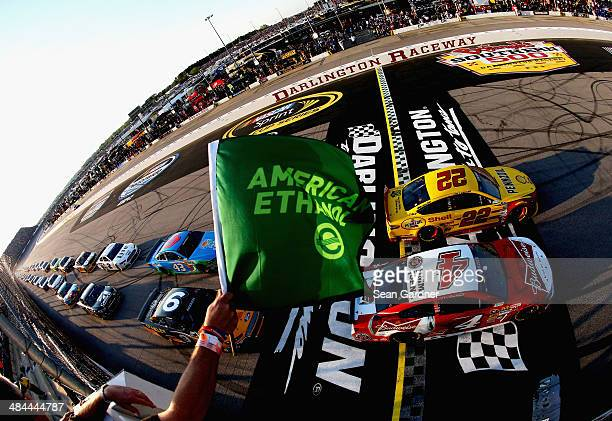 Joey Logano driver of the Shell Pennzoil Ford and Kevin Harvick driver of the Budweiser Chevrolet lead the field to start the NASCAR Sprint Cup...