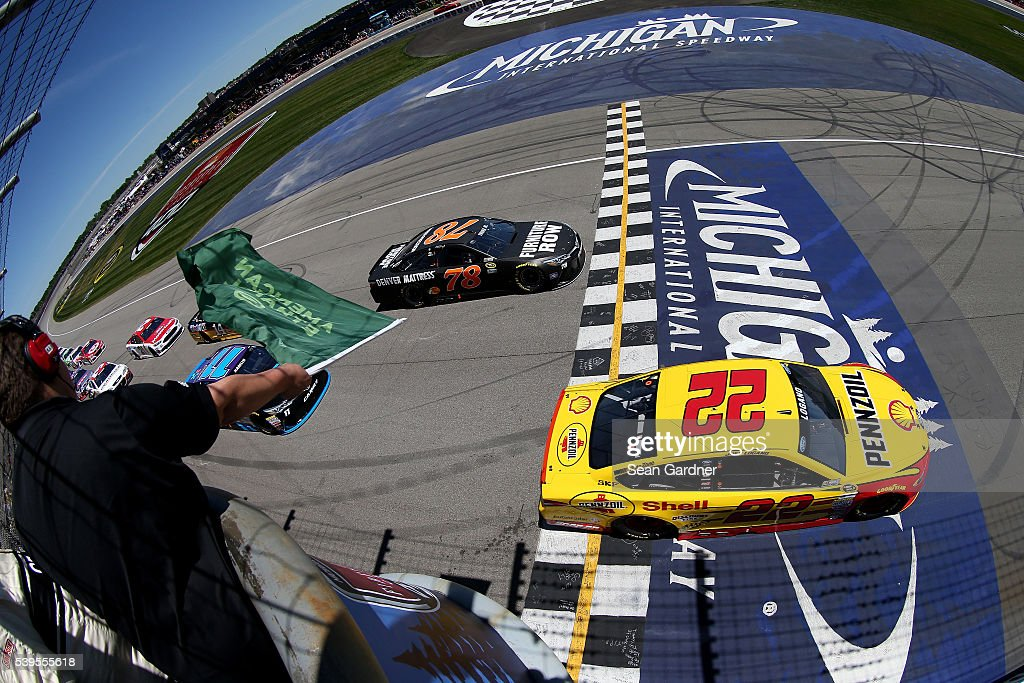 Joey Logano driver of the Shell Pennzoil Ford and Martin Truex Jr driver of the Furniture Row Toyota take the green flag to start the NASCAR Sprint...