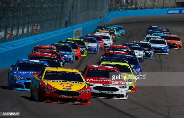 Joey Logano driver of the Shell Pennzoil Ford and Ryan Blaney driver of the Motorcraft/Quick Lane Tire Auto Center Ford take the green flag to start...