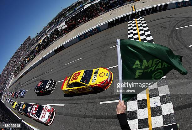 Joey Logano driver of the Shell Pennzoil Ford and Ryan Newman driver of the Quicken Loans Chevrolet lead the field to start the NASCAR Sprint Cup...