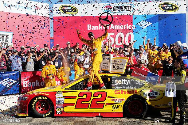 Joey Logano driver of the Shell Pennzoil Ford celebrates in Victory Lane after winning the NASCAR Sprint Cup Series Bank of America 500 at Charlotte...