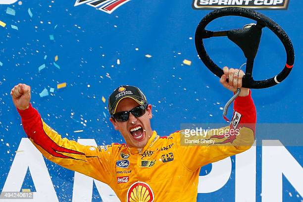 Joey Logano driver of the Shell Pennzoil Ford celebrates in Victory Lane after winning the NASCAR Sprint Cup Series CampingWorldcom 500 at Talladega...