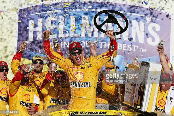 Joey Logano driver of the Shell Pennzoil Ford celebrates in Victory Lane after winning the NASCAR Sprint Cup Series Hellmann's 500 at Talladega...