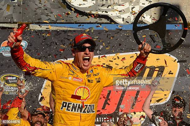 Joey Logano driver of the Shell Pennzoil Ford celebrates in Victory Lane after winning the NASCAR Sprint Cup Series CanAm 500 at Phoenix...